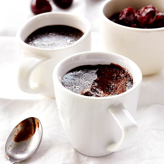Chocolate pudding with cherry sauce